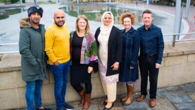 The Mind the Gap team stand in front of a fountain in Bradford city centre