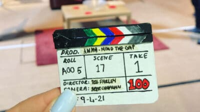 A tiny clapperboard with the text 'Prod. Anna - Mind the Gap; Roll A00 5; Scene 17; Take 1; Director: Tess Farley; Camera: Brett Chapman; 100; 9-4-21'